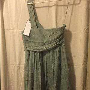 NEW. One shoulder strap. Crepe material. Flirty